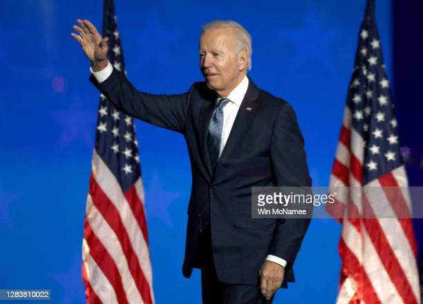 Democratic presidential nominee Joe Biden speaks at a drive-in election night event at the Chase Center in the early morning hours of November 04,...