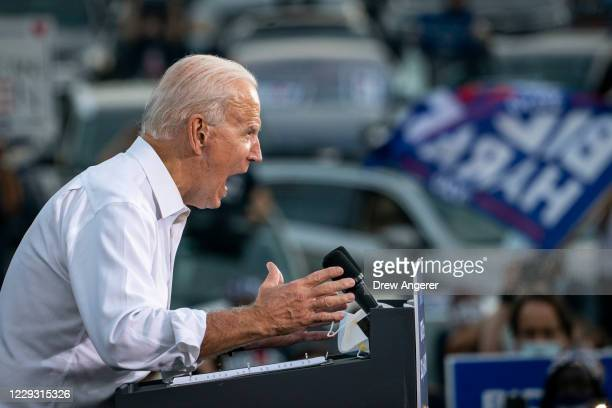 Democratic presidential nominee Joe Biden speaks during a drive-in campaign rally in the parking lot of Cellairis Ampitheatre on October 27, 2020 in...