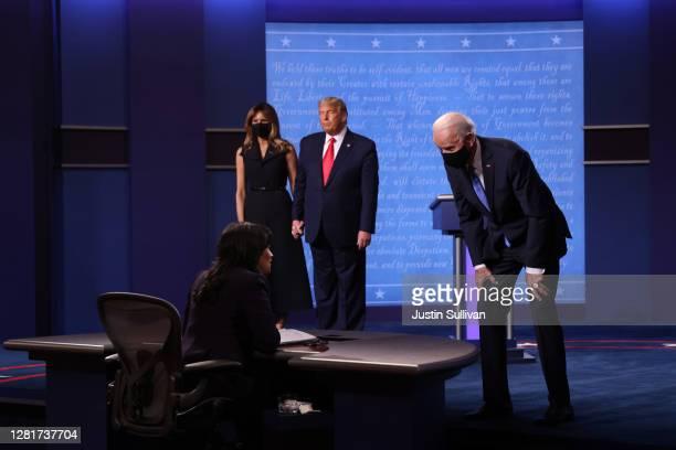Democratic presidential nominee Joe Biden speaks to moderator Kristen Welker after the final presidential debate against President Donald Trump at...