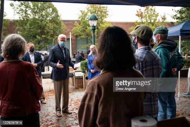 Democratic presidential nominee Joe Biden speaks to people while visiting a voter mobilization center on October 26 2020 in Chester Pennsylvania In...