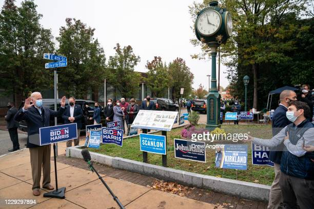 Democratic presidential nominee Joe Biden speaks to reporters while visiting a voter mobilization center on October 26 2020 in Chester Pennsylvania...