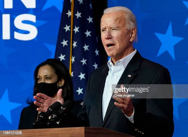 Democratic presidential nominee Joe Biden speaks while flanked by vice presidential nominee, Sen. Kamala Harris , at The Queen theater on November...