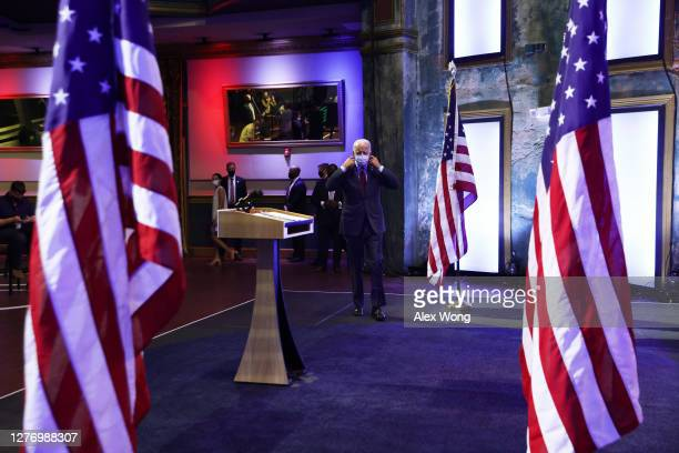 Democratic presidential nominee Joe Biden takes off his mask as he arrives at a campaign event on September 27 2020 in Wilmington Delaware Biden...