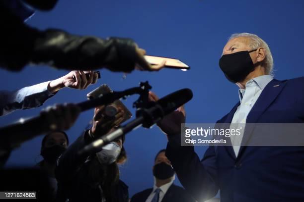 Democratic presidential nominee Joe Biden talks with journalists before departing the Detroit Metro area September 09, 2020 in Romulus, Michigan....