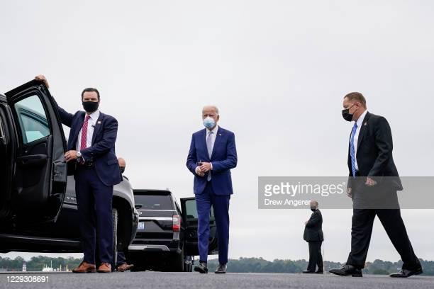 Democratic presidential nominee Joe Biden walks to his motorcade as he arrives at Columbus Airport on October 27 2020 in Columbus Georgia Biden is...
