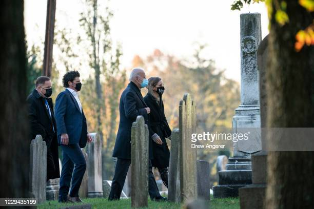Democratic presidential nominee Joe Biden walks with his granddaughter Finnegan Biden as they arrive at St. Joseph on the Brandywine Roman Catholic...