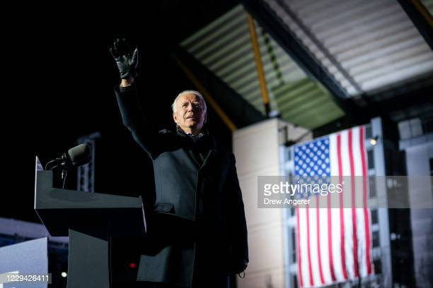 Democratic presidential nominee Joe Biden waves to the crowd as he arrives at a drive-in campaign rally at Heinz Field on November 02, 2020 in...