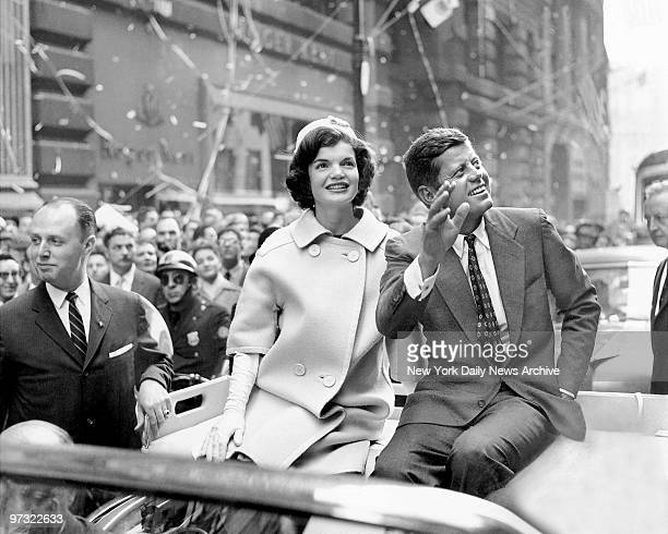 Democratic presidential nominee John F Kennedy and his wife Jacqueline ride up Broadway in a tickertape parade