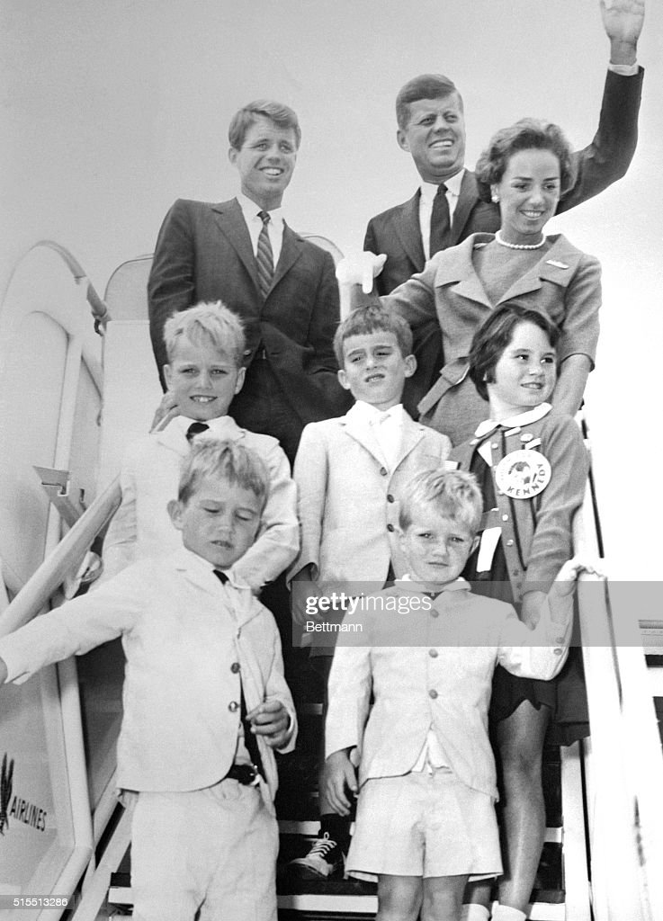 Democratic presidential nominee, John F. Kennedy waves as he boards a plane enroute to his Massachusetts home. On the ramp with Kennedy are Robert Kennedy, his brother and campaign manager (L) Mrs. R. Kennedy (R) the children are Joseph Kennedy II, Robert Shriver, Kathleen Kennedy and bottom row are Bobby Kennedy and David Kennedy.