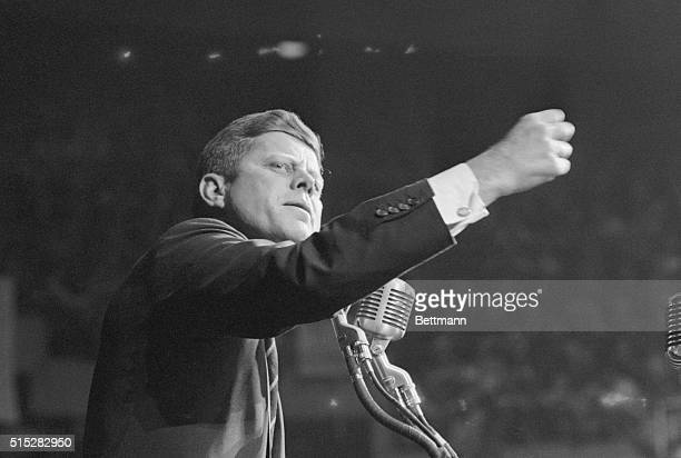 Democratic presidential nominee, Senator John F. Kennedy, clenches his fist to make a point at a Democratic wind-up rally.