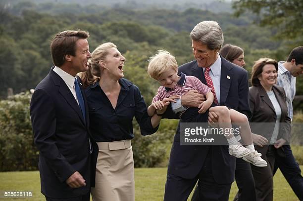 Democratic presidential nominee Senator John Kerry holds fouryearold Jack Edwards son of his running mate Senator John Edwards in his arms while...