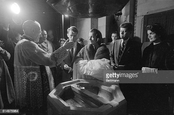 Democratic Presidential nominee shown during the baptism of his first child in this December 13th 1957 file photo Archbishop Cushing is baptizing the...