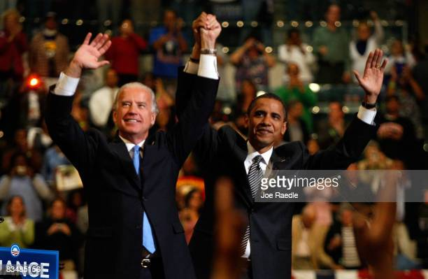 Democratic presidential nominee US Sen Barack Obama and his Vice Presidential pick Sen Joe Biden wave together during a campaign rally at Bank...