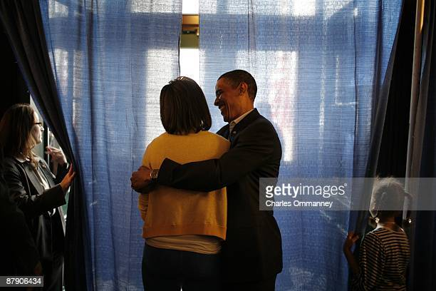 Democratic presidential nominee US Sen Barack Obama and his wife Michelle spend a few brief moments together backstage before speaking at a campaign...