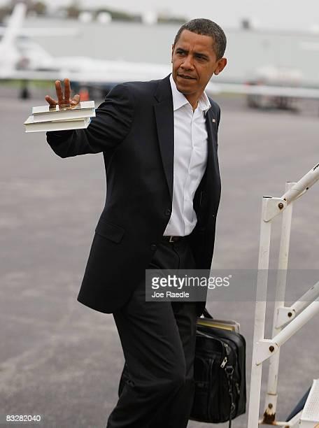Democratic presidential nominee US Sen Barack Obama boards his plane as he heads to New York for his debate against Sen John McCain at Hofstra...