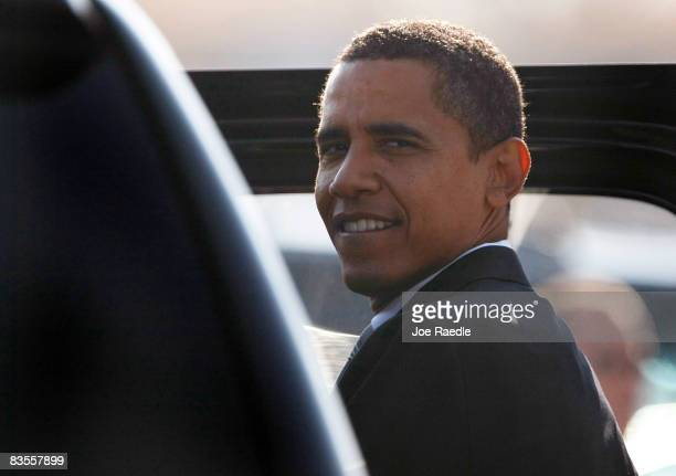 Democratic presidential nominee US Sen Barack Obama enters his vehicle after walking off his airplane at Chicago Midway International Airport to...