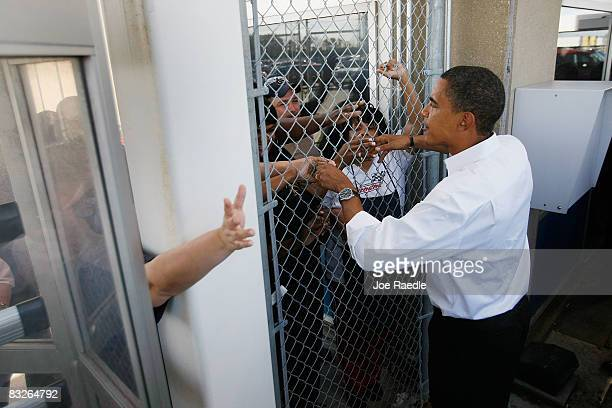 Democratic presidential nominee US Sen Barack Obama greets people behind the main gate at the Toledo Machining Plant October 14 2008 in Perrysburg...