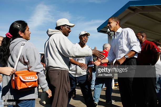 Democratic presidential nominee US Sen Barack Obama greets workers during shift change at the Toledo Machining Plant October 14 2008 in Perrysburg...