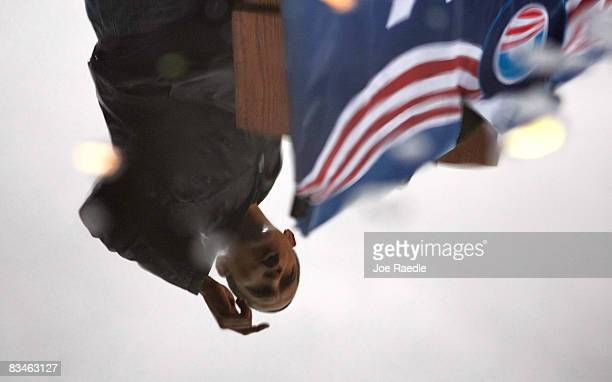 Democratic presidential nominee US Sen Barack Obama is reflected in a puddle as he speaks during a campaign rally at Widener University Main Quad...