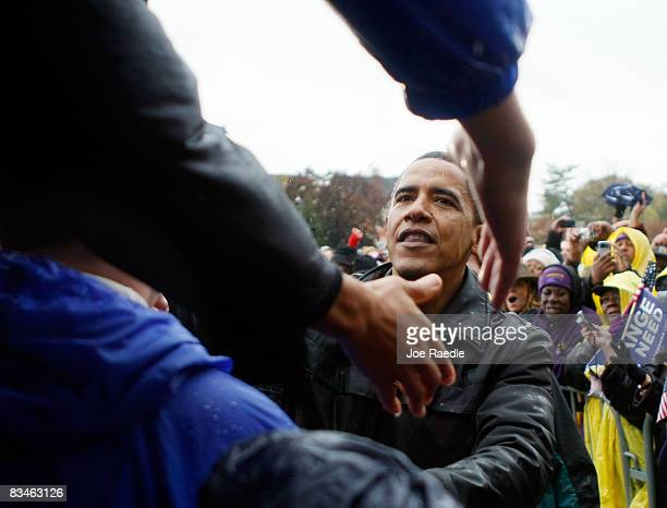 Democratic presidential nominee US Sen Barack Obama shakes hands with people during a campaign rally at Widener University Main Quad October 28 2008...