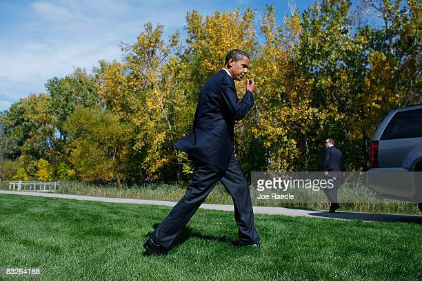 Democratic presidential nominee US Sen Barack Obama walks away after speaking to the press at Maumee Bay resort where he was staying as he prepares...