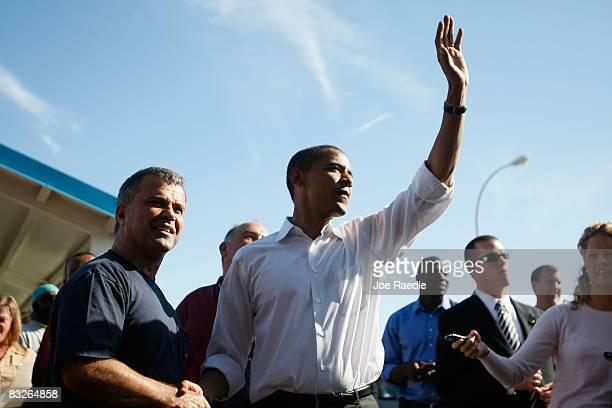 Democratic presidential nominee US Sen Barack Obama waves as he greets workers during shift change at the Toledo Machining Plant October 14 2008 in...