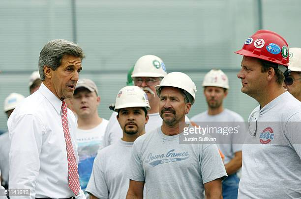 Democratic presidential nominee US Sen John Kerry talks with construction workers at a building site August 4 2004 in Davenport Iowa Kerry continues...