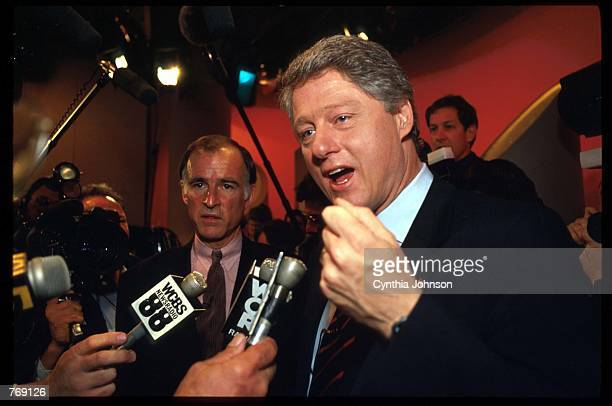 Democratic presidential nominees Governor Bill Clinton speaks while Democratic presidential nominee former Governor Jerry Brown watches April 6 1992...