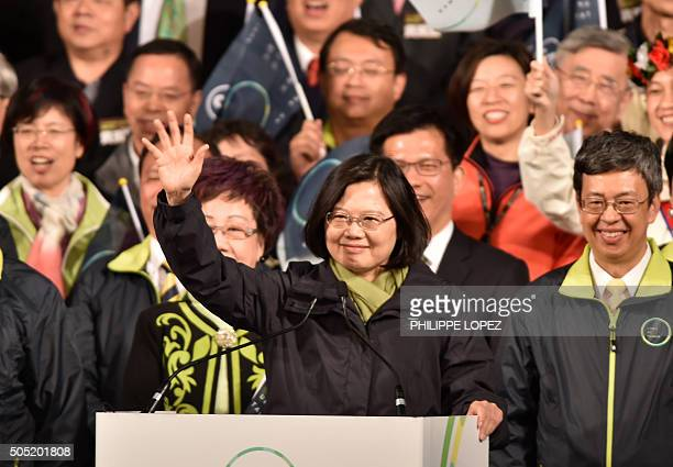 Democratic Progressive Party presidential candidate Tsai Ingwen gestures as she celebrates alongside counterpart Chen Chienjen after winning the...