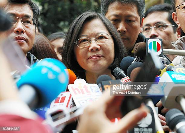 Democratic Progressive Party presidential candidate Tsai Ingwen is surrounded by media reporters after casting her ballot at a polling station on...