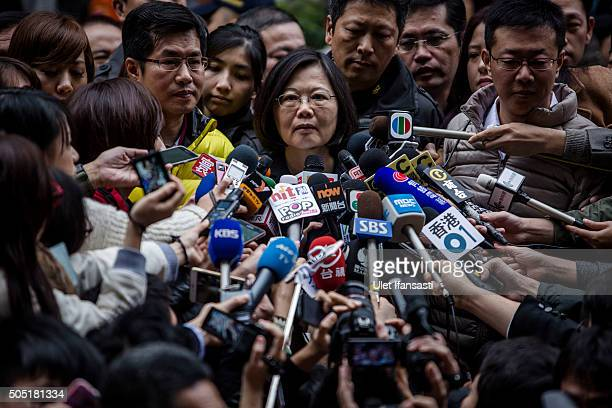 Democratic Progressive Party presidential candidate Tsai Ing-wen, talks to journalists after casting her ballot at a polling station on January 16,...