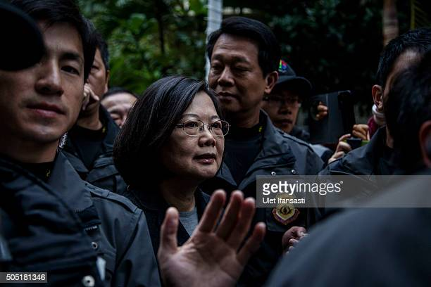 Democratic Progressive Party presidential candidate Tsai Ingwen walks leave a polling station after casting her ballot on January 16 2016 in Taipei...