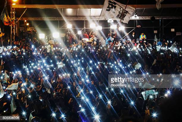 Democratic Progressive Party supporters shine lights from their mobile devices as they celebrate election results during a rally in Taipei Taiwan on...