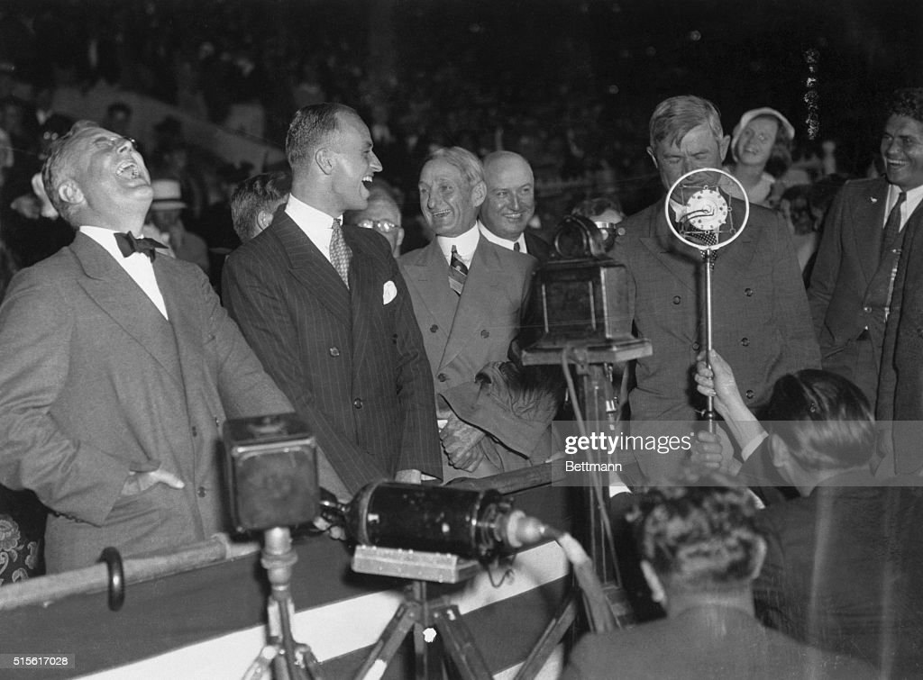 Democratic rally at Olympic Stadium (L to R) Franklin D.Roosevelt, his son James, Senator William McAdoo, Jim Farley, and Will Rogers.