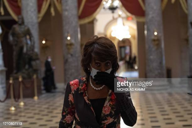 Democratic Representative from California Maxine Waters walks out of the chamber of the US House of Representatives during the debate on the...