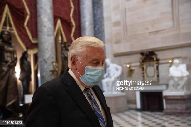 Democratic Representative from Maryland, Steny Hoyer, wears a face mask as he walks out of the House chamber during the debate on the additional 484...