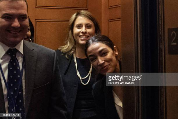 US Democratic Representative from New York Alexandria Ocasio Cortez peers from an elevator at the Capitol in Washington DC on January 16 2019