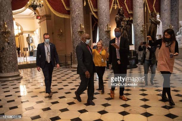 Democratic Representative from South Carolina James Clyburn speaks to reporters as he walks out of the House chamber during the debate on the...