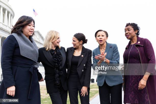 Democratic Representatives from New York Grace Meng Carolyn Maloney Alexandria OcasioCortez Nydia Velázquez and Yvette Clarke pose for a photo after...