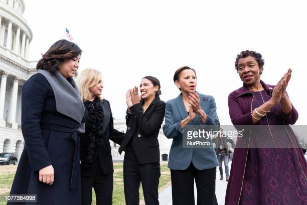 Democratic Representatives from New York Grace Meng Carolyn Maloney Alexandria OcasioCortez Nydia Velázquez and Yvette Clarke after taking a group...