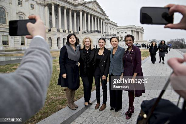 Democratic Representatives from New York including Yvette Clarke from right Nydia Velazquez Alexandria OcasioCortez Carolyn Maloney and Grace Meng...