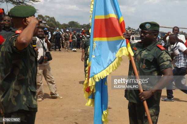 Democratic Republic of Congo Army Brigadier General Marcel Mbangu Mashita receives a Congolese National Army flag during the ceremony for his...
