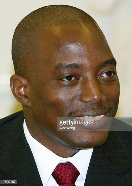 Democratic Republic of Congo Joseph Kabila smiles as he meets with US President George W Bush at the Oval Office of the White House November 5 2003...