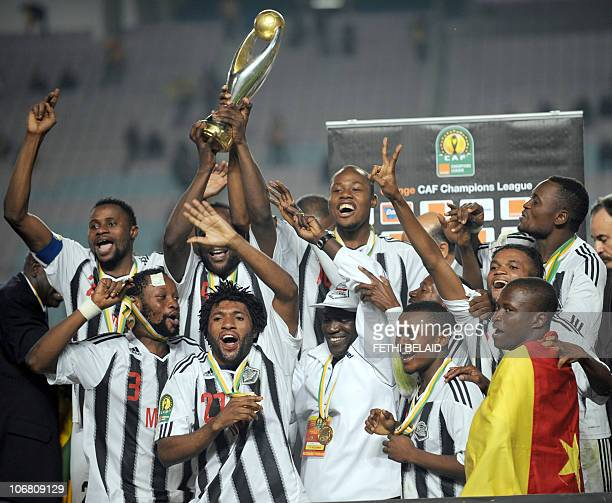 Democratic Republic of Congo side ToutPuissant Mazembe players celebrate with their CAF Champions League trophy after beating Tunisia's Esperance de...