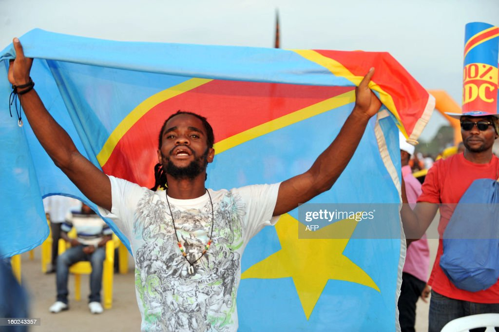 Democratic Republic of Congo's fan holds a flag as they watch the Africa Cup of Nations 2013 football match Mali vs Democratic Republic of Congo on a giant screen in Kinshasa on January 28, 2013.
