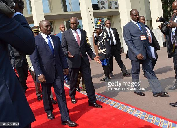 Democratic Republic of Congo's President Joseph Kabila welcomes Angola's President Jose Edouardo Dos Santos before a meeting on January 19 2015 in...