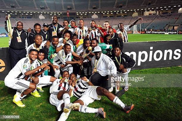 Democratic Republic of Congo''s ToutPuissant Mazembe players celebrate with their CAF Champions League trophy after beating Tunisia's Esperance de...