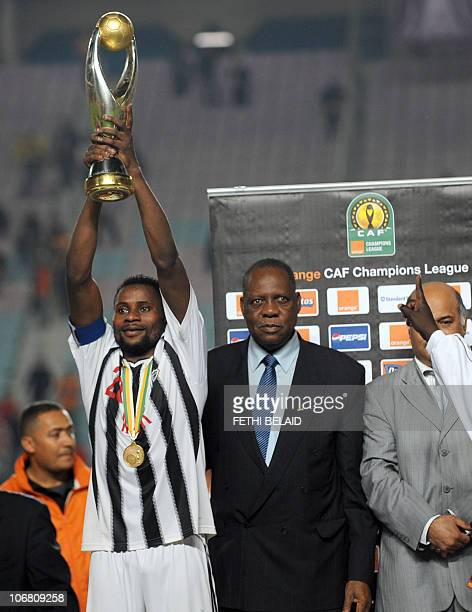 Democratic Republic of Congo's ToutPuissant Mazembe team captain Pamphile Mihayo and African football confederation President Issa Hayatou celebrate...