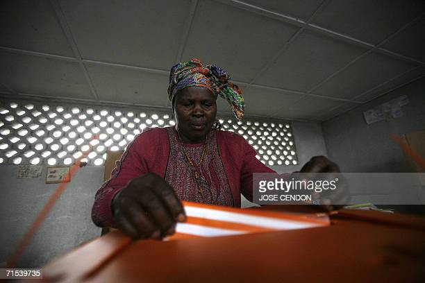 MUGUNGA Democratic Republic of the Congo A Congolese woman casts her vote at a polling station 30 July 2006 in Mugunga village near Goma Democratic...