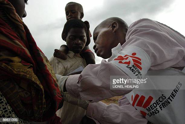 A Medecins Sans Frontiers worker looks after some patients 19 January 2006 in Dubie Katanga Local people have fled Congolese Army operations against...